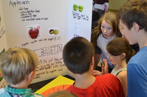 From left to right, Nate Ingebritson, Grady Wellman-Webster, Archer Hill, Eva Bonsey, and Kiley Higgins learn about the nutrition of apples.